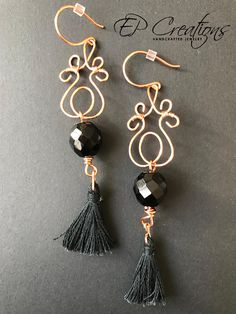 Unique rose gold wired dangle earrings with black beads & black tassel These elegant and unique earrings made out of rose gold colored wire and black Crystal beads with a handmade black tassel are designed for special occasions like date nights etc. They would match perfectly to a