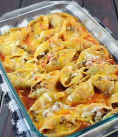 I made this with our leftover taco meat (both beef and chicken) and the only thing I did different was used manicotti shells instead because the store didn't have the jumbo shells. And I didn't measure anything, just threw it all together and stuffed the shells. It was delicious and now I know what to do with leftover taco meat! ''MEXICAN STUFFED SHELLS''