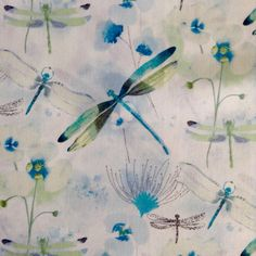 1 Half Yard Piece of fabric measuring approximately 18 inches x 44 inches. 100% cotton  Several different images and sizes of dragonflies on a white background with watercolor floral images. The largest Dragonflies are approximately 5.5 inches across.   SHIPPING:  I ship on Tuesdays and Thursdays, if you need this product sooner please contact me in advance to make sure of the delivery time. Convo me if you have any Questions