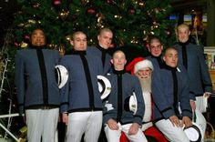 Everyone Feels Uptight Around Santa A group of men stand upright with santa