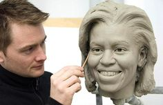 Senior sculptor Colin Jackson works on a clay head mould of Michelle Obama at Merlin Studios in London. The clay moulds are a crucial step in the six-month creation process. The full wax figure will be unveiled at Madame Tussauds, Washington DC, in March