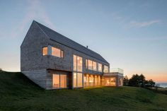Architect Omar Gandhi has completed the Harbour Heights residence in Inverness, Nova Scotia, Canada.