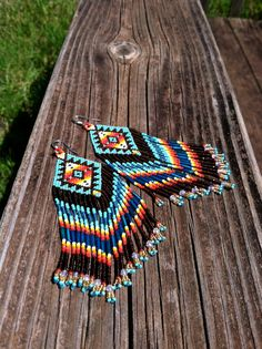 Beautiful blues and sunburst colors! These will be particularly loved by those who cherish Pendelton blankets. Handmade with size 13 seed beads. Light
