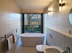 Bathrooms: a vineyard view from Cloudy Bay's guest quarters -