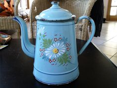 Enamel coffee  pot, blue with a white daisy.