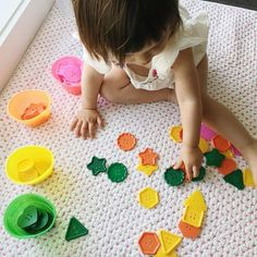 Colour matching activity in action - perfect for colour recognition and practicing fine motor and hand eyed coordination skills - she did great, sorting colours easily and showed some interest in the shapes too.