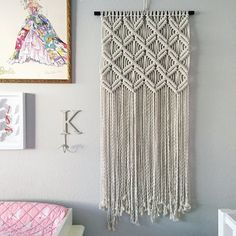 Macrame Wall Hanging Pattern Pattern Name - Fourteen X Buy three patterns and get one free! Coupon Code: MyFreePattern This is a digital download pattern/ DIY for a Macrame Wall Hanging that I designed. It list the materials needed as well as a step-by-step on how to complete the project. Suitable for a beginner if you work alongside my YouTube Macrame videos which can be found at tinyurl.com/reformfibers ***This is for the pattern only; completed project, or Knot Guide not inclu...