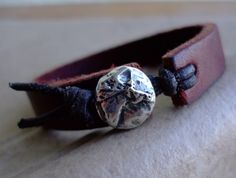 Brown leather cuff bracelet with large focal button - very simple & quite eye-catching  #handmade #jewelry