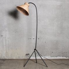 Available for preorder. Due to arriveJune 2021 Rattan, woven wicker and cane are iconic materials used throughout the 20th Century for their timelessness, striking lines, and warm natural tones. Our collection of rattan lighting is our love letter to those Mid-Century designers, like Mies van der Rohe, that we so oft Black Floor Lamp, Cool Floor Lamps, Artist And Craftsman, Mid Century Modern Design, Rattan, Classic Style, Mid-century Modern, Bulb