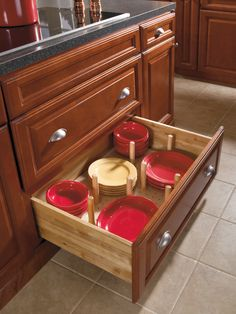 Aristokraft's pegged dish organizer allows you to customize pegs for your dish sizes.