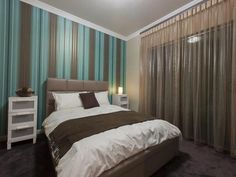 Strikingly bold wallpaper with sheer curtains. Gives a feeling of luxury with a strong sense of confident personality.