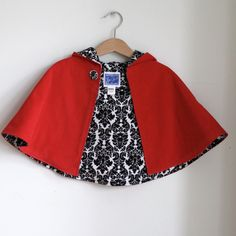 Little Red Riding hood newborn or toddler girls cape with black and white damask lining - sizes newborn, 3m, 6m, 12m, 18m, 2t, 3t, 4t. $45.00, via Etsy.