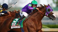California Chrome, ridden by Victor Espinoza, wins the 140th Kentucky Derby.