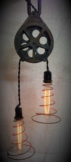 Doesn't get much cooler than this old pulley functioning now as a Steampunk light.