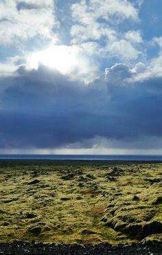 Rain approaching the lava fields near the beach. Iceland. My photo.