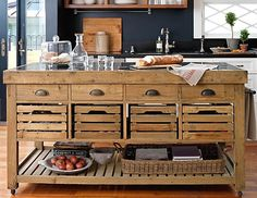 beautiful island with storage for onions and potatoes and a stone top industrial kitchen