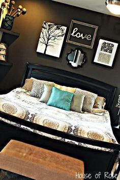 Sometimes a dark accent wall creates fullness and a homey feel to a room. Love this wall coupled with the bright bed pillow.
