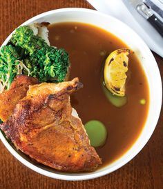 Chicken cooked under a brick is served with broccolini, roasted potato and grilled lemon - Review: Duck Duck Goose - Bethesda Magazine - September-October 2016 - Bethesda, MD