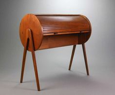 Teak Roll Top Desk  HEIGHT:36 in. (91 cm) WIDTH:38 in. (97 cm) DEPTH:18 in. (46 cm) DEALER LOCATION:New York, NY NUMBER OF ITEMS:1 REFERENCE NUMBER:| From a unique collection of antique and modern desks and writing tables at https://www.1stdibs.com/furniture/tables/desks-writing-tables/