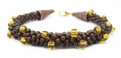 Brown and Amber Kumihimo Bracelet by kiddercreations on Etsy