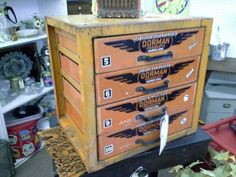 SOLD - This vintage metal cabinet is painted orange with black and white details - it was supplied by the Dorman products Cincinnati Ohio.  It originally held screws clamps and bushings. Each drawer has many small compartments. ***** In Booth D4 at Main Street Antique Mall 7260 E Main St (east of Power RD on MAIN STREET) Mesa Az 85207 **** Open 7 days a week 10:00AM-5:30PM **** Call for more information 480 924 1122 **** We Accept cash, debit, VISA, Mastercard, Discover or American Express