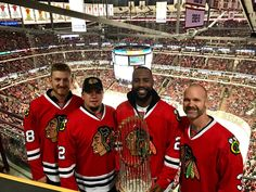 Mike Montgomery, Kyle Schwarber, Jason Heyward & David Ross of the World Series Champion Cubs brought the trophy to the Blackhawks game!