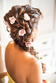 The Best Real Bride Hairstyles of 2015: Best bridal braid - unique, long side braid ponytail with roses intertwined for a spring or summer wedding