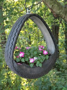 #pots #planters #pottery #containers  Hanging planter made from a tire