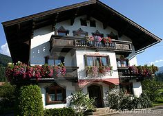 Pretty flower decked Austrian house in the Tyrolean village of Kirchberg