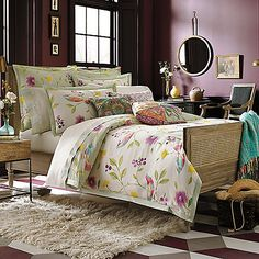 The floral vine pattern in the Collier Campbell Duvet Cover Set provides a colorful place to rest. Featuring a unique singing birds motif, this beddong provides both welcoming and warm colors with a soft jaded green flange.