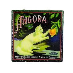A Handmade Coaster Angora - Vintage Citrus Crate label, adorns this classy handcrafted coaster made with a handpainted upcycled tile.     Antique advertising art is scanned, digitally enhanced, and restored, so that this piece of history can be forever remembered and preserved within a Stella Divina coaster displayed in your home.       Coasters are:   - waterproof & alcohol proof.   - heat resistant to 200 degrees   (great for a coffee, not for a hotplate.)   - UV-Protected, so the images…