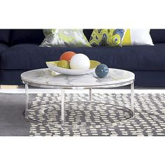 """smart round marble top coffee table ringside table. Open cylinder construction of slick polished chrome tops out in Carrara-style white/grey marble. Smooth and cool with a subtle silvery glint of crystallization. Sports low-rise genes just 12"""" off the floor."""