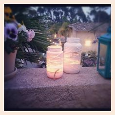 Lanterns. Save spaghetti sauce jars, wrap with rubber bands and paint. Add a votive and some twine