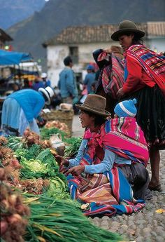 Pisac Market, Peru. Repinned by Elizabeth VanBuskirk. If those at the market have brought corn to trade or sell, you know they live in the lowlands, like the river valley near Pisac. One major purpose of Andean markets is for people who live at the high altitudes--eg 12,000 above sea level can come to market to trade their potatoes, which can be grown high up, for lower products like vegetables, fruit, corn.