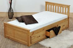 A warm wooden bed with built in storage