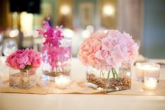pink hydrangea and peony centerpieces - wedding photo by Melissa Jill Photography