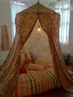 Bed Tent... but for little man with, maybe planet fabric with the lights as stars in his room?