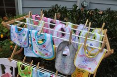 Elizabeth & Co. Guest decorated bibs at a baby shower.