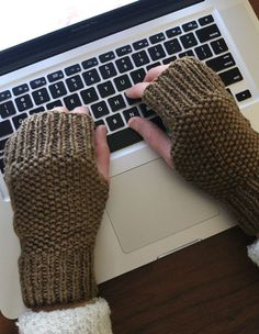 These sweet little mitts are easy to make – great for beginning knitters – and will keep your hands toasty while your fingers keep typing. If you've ever tried to type in a cold office or house you'll know the value of a pair of fingerless hand covers. These are more simple than fingerless gloves or