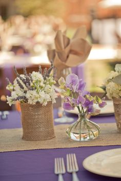 Purple and white centrepieces with hessian overlay