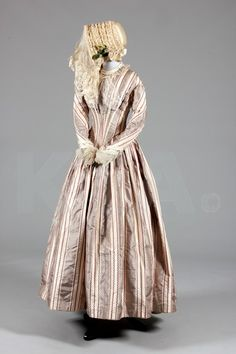 Gown and bonnet from the 1840s.  It is a wedding gown, and the provenance information is available on Kerry Taylor auctions' website.