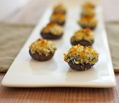 stuffed mushroom or spinach - artichoke dip...... can't decide? put 'em together!!! Spinach and Artichoke Dip Stuffed Mushrooms.... :-)