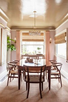 "In spaces that connect, reverse the placement of the paint colors in one room. ""Here, we used a glossy café au lait on the ceiling and a soft gray-lavender on the walls,"" says Warner. It's a unique effect that is still subtly cohesive."