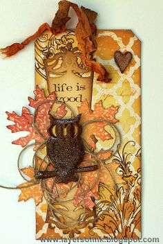 Wax Paper Resist Tutorial - Layers of ink. Step-by-step tutorial for a fun resist technique using wax paper and Sizzix dies, Stampers Anonymous Tim Holtz stamps and Distress Ink.