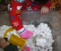 make a winter sensory bin with large cotton balls. Add in some scoops and buckets. Put on mittens if you like!