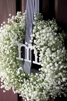 Love this combo of baby's breath, ribbon and the monogram! #BabyCenterBlog