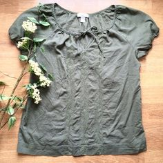 Ann Taylor Loft peasant blouse Olive Green, short elastic sleeve, pullover peasant blouse from LOFT. Barely worn, easy care. Slight v-neck with tie and beautiful shiny green embroidery down the center panel of the front. Loose fit. 100% cotton. LOFT Tops Blouses