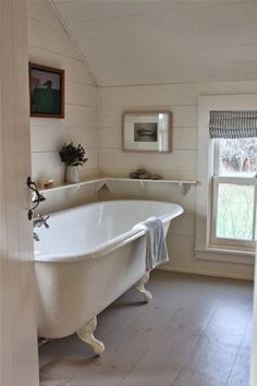 Sheila Narusawa overhauled this cottage bathroom with a wraparound open shelf, a white clawfoot tub, and painted wood floors. See the rest of the house in A Cottage Reborn in Coastal Maine.White Bathrooms from the Remodelista Architect/Designer Directory Home Interior, Interior Design, Bathroom Interior, Interior Decorating, Decorating Ideas, Decorating Bathrooms, Stylish Interior, Interior Livingroom, Interior Modern