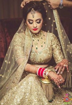 Looking for Bride in gold lehenga with kaleera? Browse of latest bridal photos, lehenga & jewelry designs, decor ideas, etc. on WedMeGood Gallery. Golden Bridal Lehenga, Indian Bridal Lehenga, Indian Bridal Makeup, Indian Bridal Outfits, Indian Bridal Wear, Bridal Dresses, Indian Wear, Pakistani Bridal, Indian Dresses