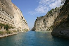 view of the Corinth canal in Peloponnese,Greece.                The Corinth Canal, carrying ship traffic between the western Mediterranean Sea and the Aegean Sea, is about 4 kilometres (2.5 mi) east of the city, cutting through the Isthmus of Corinth that connects the Peloponnesian peninsula to the Greek mainland, thus effectively making the former an island